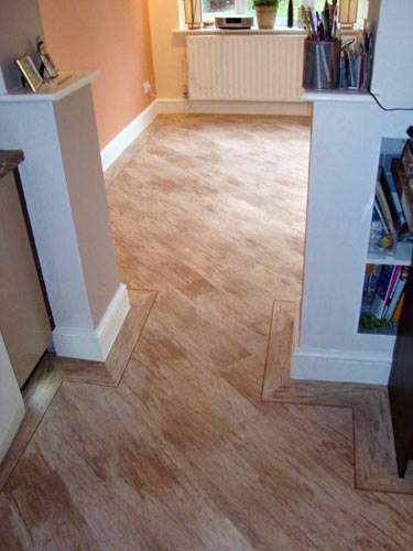 Can you lay ceramic tile over vinyl flooring